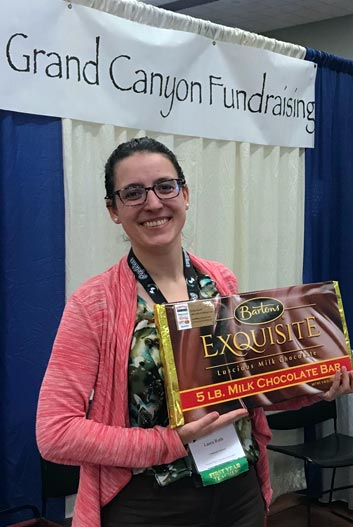 Conference giveaway winner with giant candy bar